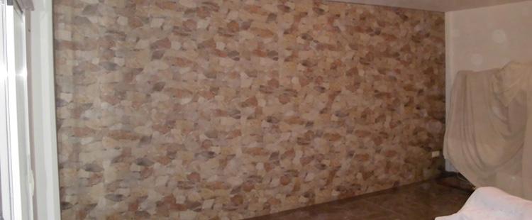 Reforma de una pared alicatada en imitación de piedra
